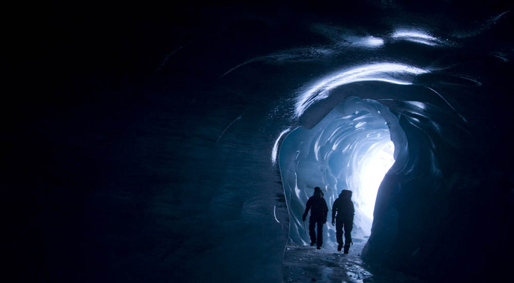 Morgan Sahlen and Maria Ludvigsson exploring icecave on glacier Mer de Glace in Chamonix, France