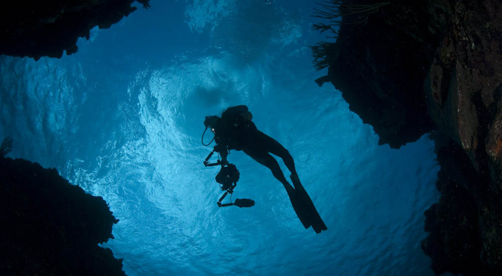 Silhouette of diver against blue water in Snapper bay, Grand Cayman